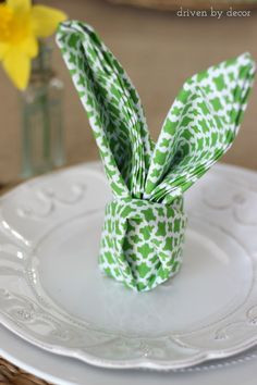 Napkin folded into rabbit ears - so cute for an Easter table setting!