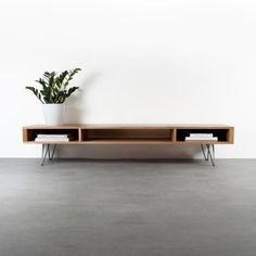 """Mid century wide TV stand or coffee table. Minimalist solid oak on hairpin legs """"Marston"""" - Our Marston extra wide TV stand or long coffee table is an extra wide, low looped, minimalist piece - Low Coffee Table, Modern Coffee Tables, Mid Century Coffee Table, Coffee Coffee, Mid Century Modern Design, Mid Century Style, Living Room Tv, Living Spaces, Tv Stand Ideas For Living Room"""