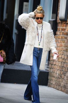 For The Boho Babe - Shearling detail innately imparts a bohemian vibe to its wearer. Kate Hudson opted for a modern-day Penny Lane look with a Loeffler Randall coat, denim flares and a colorful pendant.