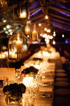 lantern lights hanging from the tent will make a perfect outdoor reception, providing a romantic evening environment