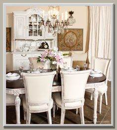This light and airy setting accented by the antique crystal chandelier is perfect for the Spring