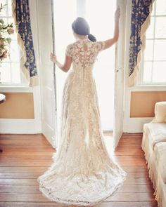 This lace wedding gown is really gorgeous. See other views in the full gallery: http://www.stylemepretty.com/gallery/gallery/6620
