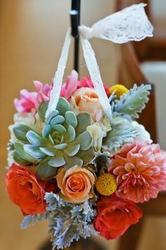Shepherds Hooks Arrangements for wedding ceremony. Coral, mint, peach, yellow. Succulents, dahlias, roses, billy balls, dusty miller, lace. Mariners Church Newport Beach. Florals by Jenny