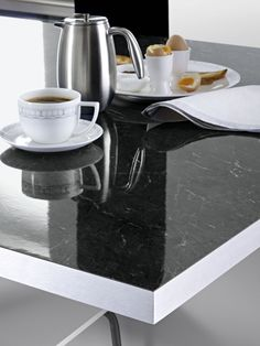 Benchtop Laminex DiamondGloss Andalucian Marble with Laminex Brushed Steel edging.