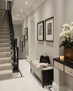 Monochrome colour palette for this compact entrance. We designed a floating shelf/ drawer unit for storage of keys and post and stuck to a…