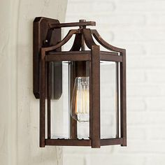 A handsome outdoor wall light that blends contemporary design with a traditional bronze finish.