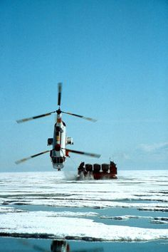 Columbia Helicopters Boeing Vertol 107-II during a test flight near Prudhoe Bay on Alaska's North Slope, June 1982. The chopper is making the 50-mile return from a newly tapped oil well on Alaska Island, towing a 170-tonne hover-barge with 50 tonnes of weight added. Despite adverse conditions, the test was a success. (Photo: Ted Veal, © Columbia Helicopters, Inc.)