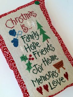 Happy holidays!  This cute Christmas sampler is stitched on burlap linen. Measures approximately 13 x 9. Perfect size for tucking on a shelf or