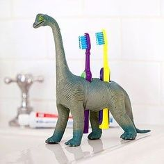 DIY decoration for kids room - Drill holes in plastic toys to make FUN toothbrush holders- LOVE this idea for a kid's only bathroom.