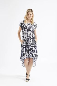 A dress for swirling! We love a feminine drape and a dramatic hemline, and of course pockets. This white ground dense chiffon dress with an exclusive print that has the impression of an animal but is actually a tie dye has both black and navy within. Its super light and breezy, great for hot days, but due to the light