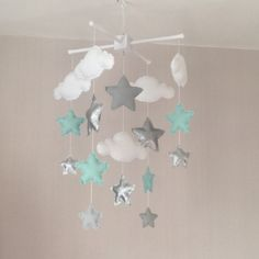 Baby mobile - Crib mobile - Cot mobile - Star mobile - Cloud Mobile - Nursery Decor - Clouds and stars - Silver, pale mint green, pale grey by EllaandBoo on Etsy https://www.etsy.com/listing/229312565/baby-mobile-crib-mobile-cot-mobile-star