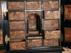 Cabinet, (detail). Place of origin: Cheb (formerly Eger). Date of origin: 1648. Pine wood, black-stained pear wood, colourful relief intarsia, gilded brass ferrules. 130.5 x 103.5 x 52 cm. -The Princes Czartoryski Museum-