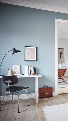 I love this fresh home with the blue walls. The living room has been painted in a cool and light grey, which looks fresh in combination with the blue peeking through from the bedroom, yet has a warm look because … Continue reading → Blue Walls, Home, Light Blue Walls, House Interior, Home Office Design, Living Room Wall, Blue Painted Walls, Office Wall Colors, Blue Wall Colors