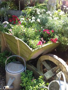 I have an old rusted wheel barrow. Maybe I should make it into a planter.