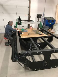 One of our military veterans (Daniel) wiring up a new ProSteel 4x8 table for a new customer