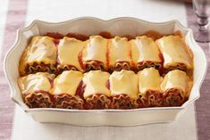 Cheesy Lasagna Roll-Ups...this could be modified to use turkey instead of beef and low fat cheese, but looks yummy.
