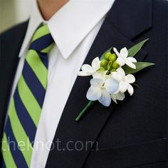 boutonniere made of hydrangeas, roses, and hypericum berries to coordinate with the bold, striped ties.