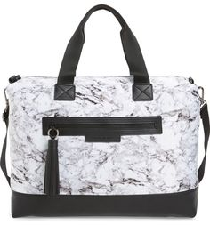 A striking black-and-white pattern draws attention to this street-chic tote with a roomy, organized interior that's perfect for carrying essentials to and from the gym or for a laid-back weekend trip.