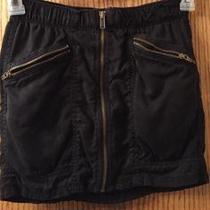 H&m skirt Divided by h&m mini skirt. Zips all the way down. Has 2 zipper pockets H&M Skirts Mini