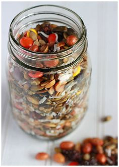 I'm so doing this!  Ingredients        1 cup shelled pumpkin seeds, roasted and salted      ½ cup sunflower seeds, roasted and salted      ½ cup sweetened coconut flakes      ¾ cup dried dates, chopped      ½ cup red-skinned Spanish nuts      ¾ cup Reece's pieces    Instructions        Stir together all ingredients in a large bowl.      Store at room temperature in an air-tight container.    Makes 4 cups