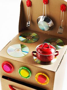 Make this before Christmas to go with play food sets stored and ready for gifting. It's cute, but not too sturdy, as it's just cardboard. Good use of the boxes, though, and I love that it's mostly recycled products. Old CDs for the burners? Genius!!
