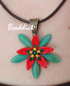 """Starflower"" pendant. Pattern by Andrea Palásti. Beaded by Beaddict. Seed beads, dagger, chili beads."