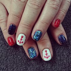 Blue, red, and white nails with glitter and anchor