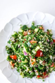 A refreshing parsley salad with bulgur, tomatoes, cucumbers and tomatoes dressed with a lemon vinaigrette. Tips for making the best tabouleh.