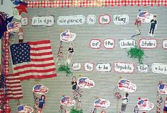 Pledge of Allegiance.  I love the handprint flags with the students pictures!