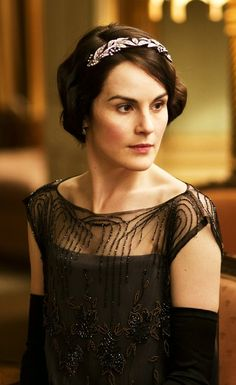 Michelle Dockery as Lady Mary Crawley wearing a beaded black evening gown with sheer bodice. Downton Abbey