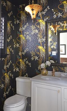 Stunning Bathroom Room Features Nina Campbellu0027s Paradiso Wallpaper Framing  Window With Black Moldings And Black Plantation
