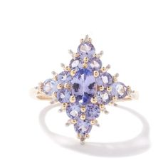 A wonderful Tanzanite Ring made of 9k Gold featuring highly collectable Tanzanite from Tanzania with dazzling Diamonds. | Gemporia.com