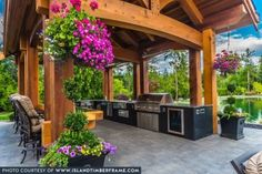 Traditional mortise and tenon joinery, oversized members and a unique design make this Western Red Cedar Outdoor Kitchen an iconic outdoor living space. Pergola Swing, Cheap Pergola, Backyard Pergola, Pergola Plans, Backyard Landscaping, Pergola Shade, Pergola Kits, Landscaping Ideas, Outdoor Living Rooms