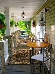 beautiful porch - like the hanging light fixture