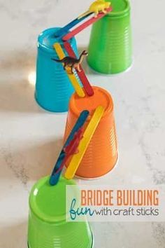 Work on fine motor skills with a craft stick bridge building activity that invites creative play, too! Your preschoolers will love this super simple construction project. #engineeringforkids #STEAMforkids