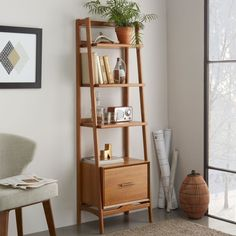 ibrary building. Inspired by American modern design, the Mid-Century Narrow Bookshelf borrows its slim legs and bevelled edges from iconic '50s and '60s furniture silhouettes. Featuring three fixed shelves and a filing cabinet drawer, it's a practical storage piece in the living room or study.