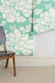 Dress-up your laundry room with this lovely turquoise paper design. Paeonia Wallpaper | anthropologie.com