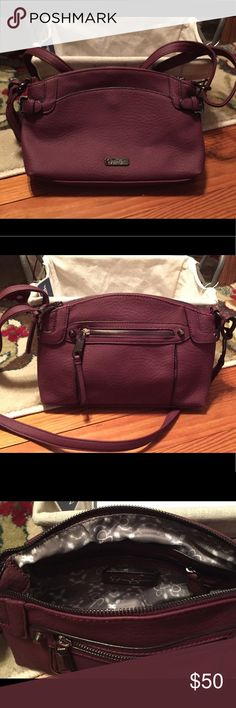 Jessica Simpson Burgundy Crossbody Burgundy crossbody with chrome/black accents. Brand new only used one time. Jessica Simpson Bags Crossbody Bags