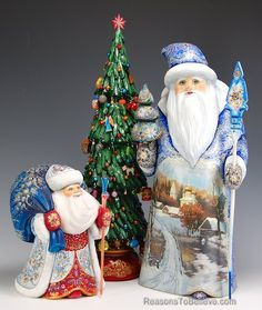 Two Russian Santas, 8 and 16 inches tall, with large carved tree.