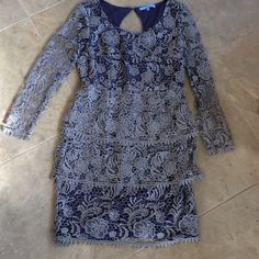 Antonio Melani lavender lace dress This gorgeous dress features 3 layers of lavender lace ruffles on the skirt, sheer lace sleeves, and a delicate keyhole closure in the back. Hidden zip closures and a darker purple lining complete the demure and very flattering look. One spot of slightly pulled fabric from the hook and eye closure on the back of the dress, only if you know what to look for (see pic 4) priced accordingly ANTONIO MELANI Dresses Long Sleeve