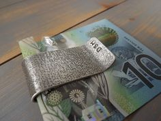 Shop thousands of beautiful handmade and designed gifts by the best creatives in the UK on nuMONDAY. The UK's largest handmade and creative marketplace. Silver Money Clip, Money Clips, Great Gifts For Men, Hand Stamped, Personalized Gifts, Sunglasses Case, Initials, Anniversary, Texture