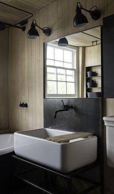 The sink has a custom welded steel base.