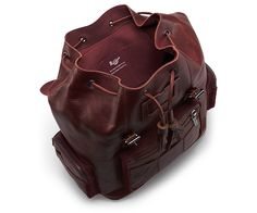 The Big Slouch Backpack is a newer style added to our Bag Collection. Convenience and refined styling are its key components. The Gunmetal hardware, tassled drawstring closure, and a traditional lightweight oxblood suede with medium nap speak for its refined style. Its water-resistant Inuck leather, three outside pockets, and its inside pocket with four compartments make this backpack extremely versatile.