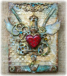 Hi All! Today, I'd liketo share another mixed media canvas I made using some of my favorite Dusty Attic chipboard! (see below for give-away) This is a small 5x7 canvas on which I used texture paste and stencils and lots of bits and pieces of my Dusty...