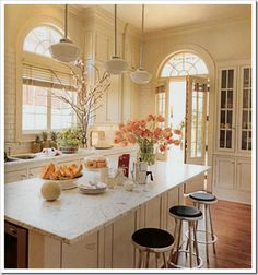 peachy beige kitchen. Livened up with flowers & natural light