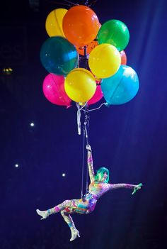 The pop star certainly went above and beyond to entertain her fans during her Prismatic world tour. Clutching onto some ginormous balloons, Perry soared above the audience during the opening night in Belfast, Northern Ireland on May 7, 2014.