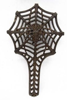 """Spider & Web Trivet ~ Cast Iron, 9 1/2"""" x 5 7/8"""" w/four 1 1/4"""" legs. On reverse: Rd No 196845 (for 1892) & bracket device. Filed gate mark along edge."""