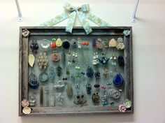 Earring holder I made out of an old picture frame and screen door fabric.