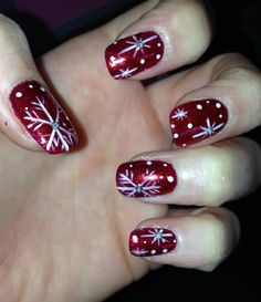 Merry Christmas. Bio Sculpture gel no74 red with red glitter and hand painted snowflakes by Kate Inman Www.pampetedtoperfection.co.uk