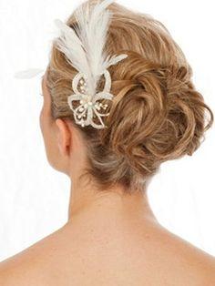 peinado de novia con plumas  http://www.bodacor.com/bodas-zaragoza-huesca-teruel-pamplona/categorias/belleza-estetica/peluqueria-maquillaje?term_node_tid_depth=all